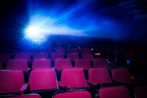 A bright projector shines in a cinema movie theater